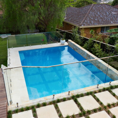 A small glass mosiac pool with greenery around it in Manly