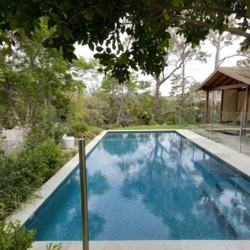 Fully Tiled Glass Mosaic pool surrounded by trees and garden in Gladesville
