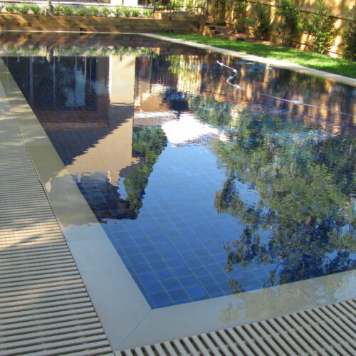 Fully Tiled Glass Mosaic Pool in a backyard in St Ives
