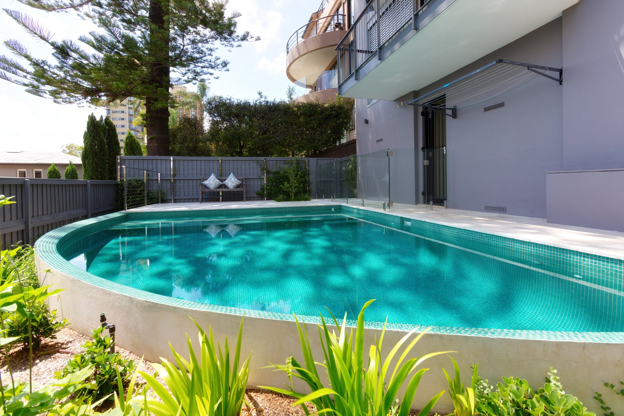 Private swimming pool in a backyard of a house in Darling Point