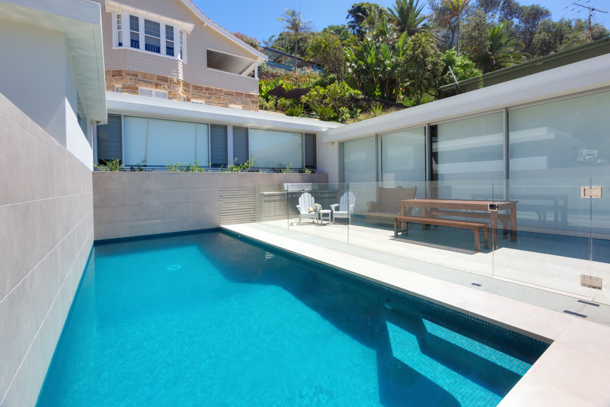 A Small Fully Tiled Glass Mosaic pool in Palm Beach
