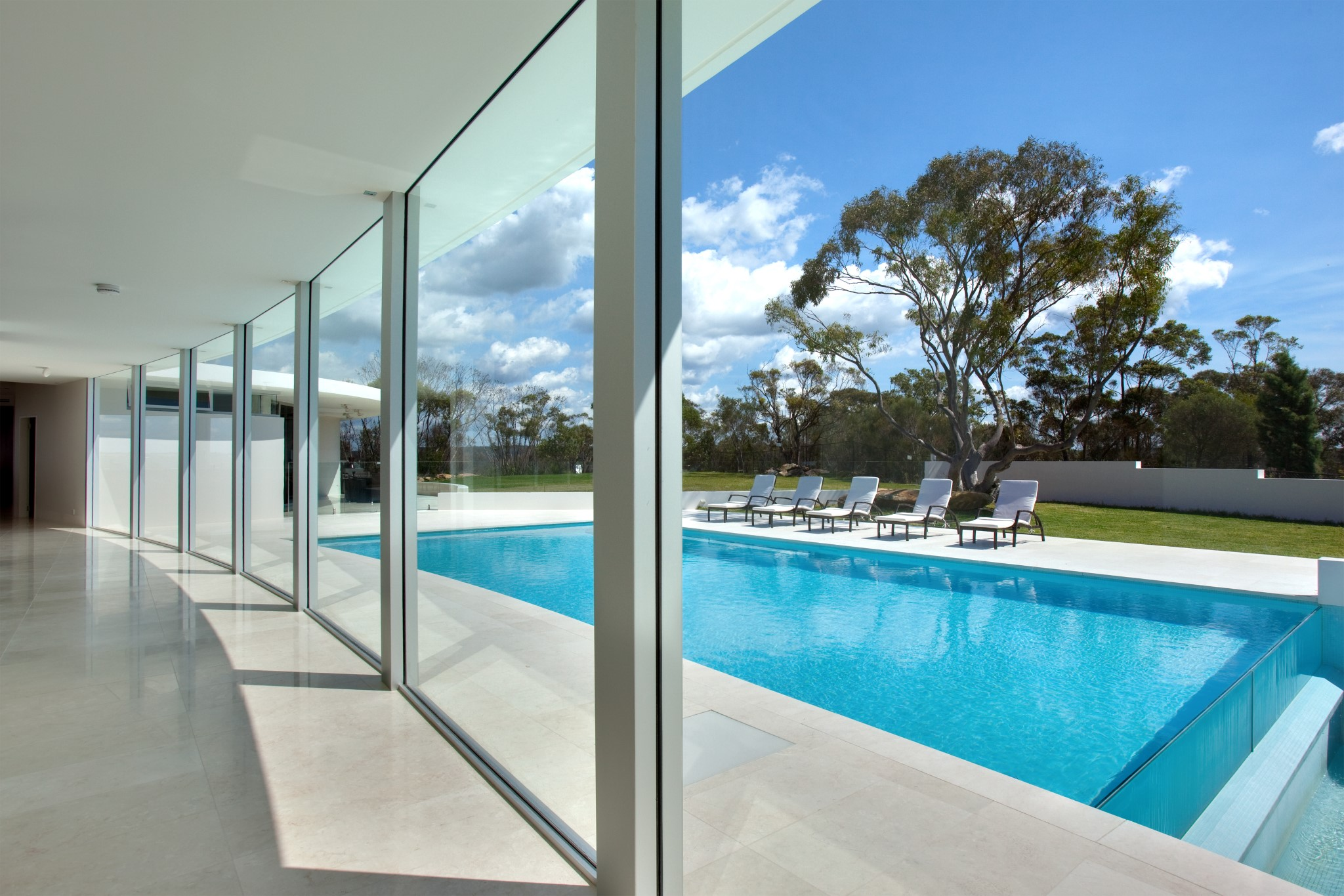Private swimming pool in a backyard of a luxurious house in Elanora Heights