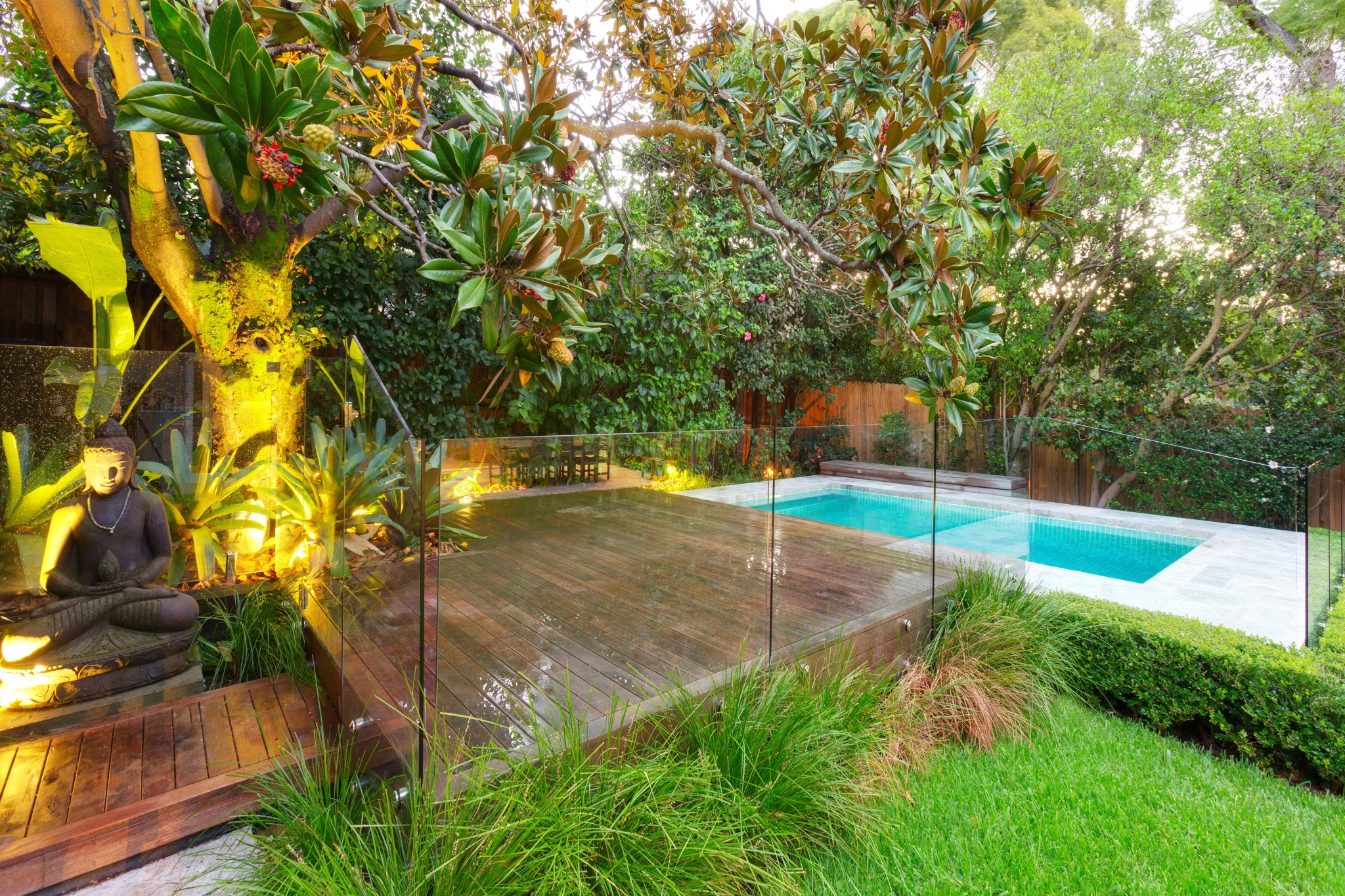 Classic Design Swimming Pool surrounded by plants and trees