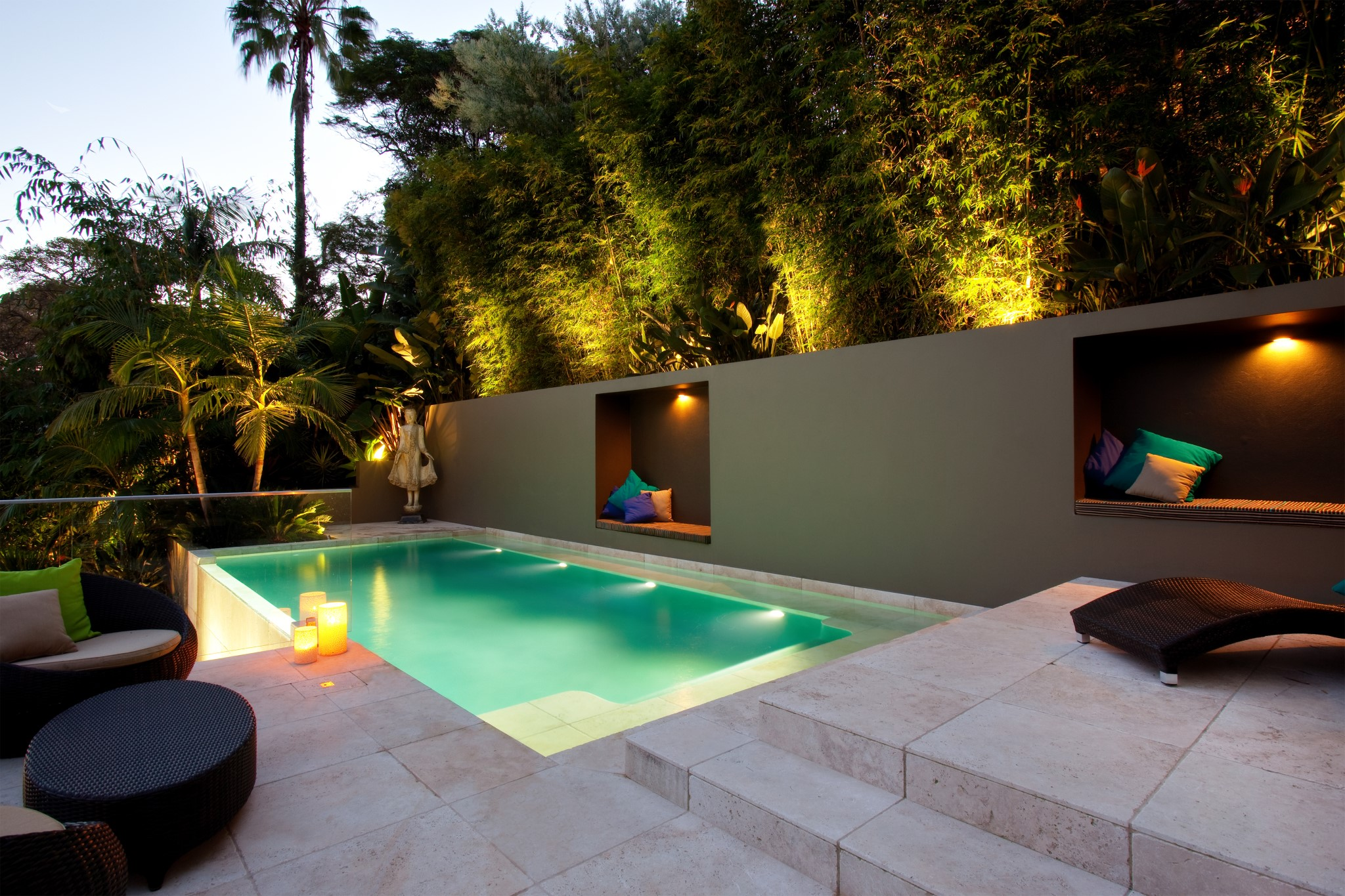 A plunge pool in a backyard of a luxurious property