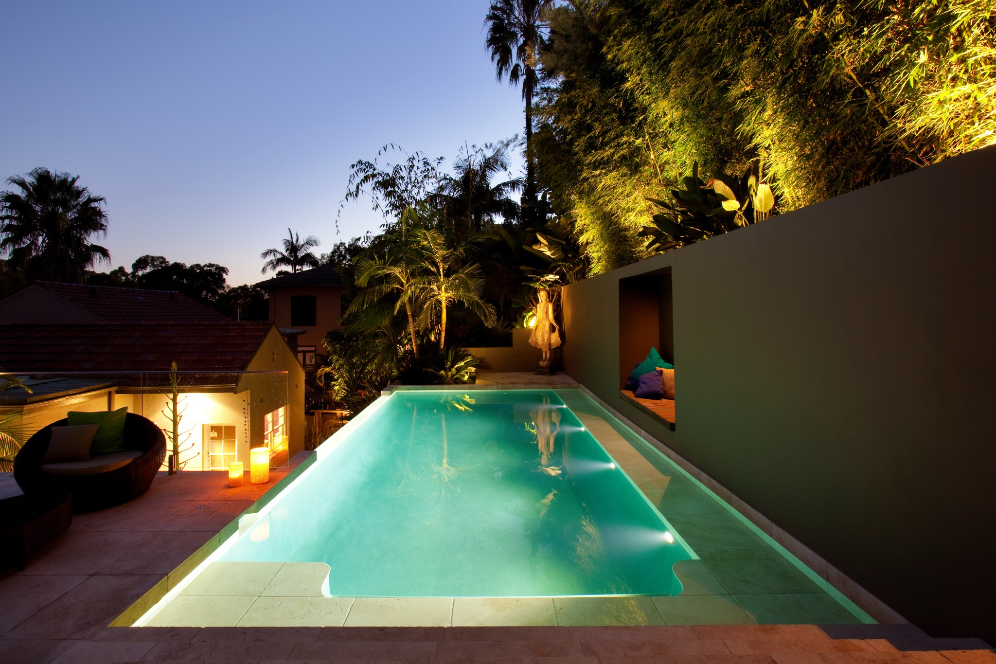View of an Illuminated swimming pool at night