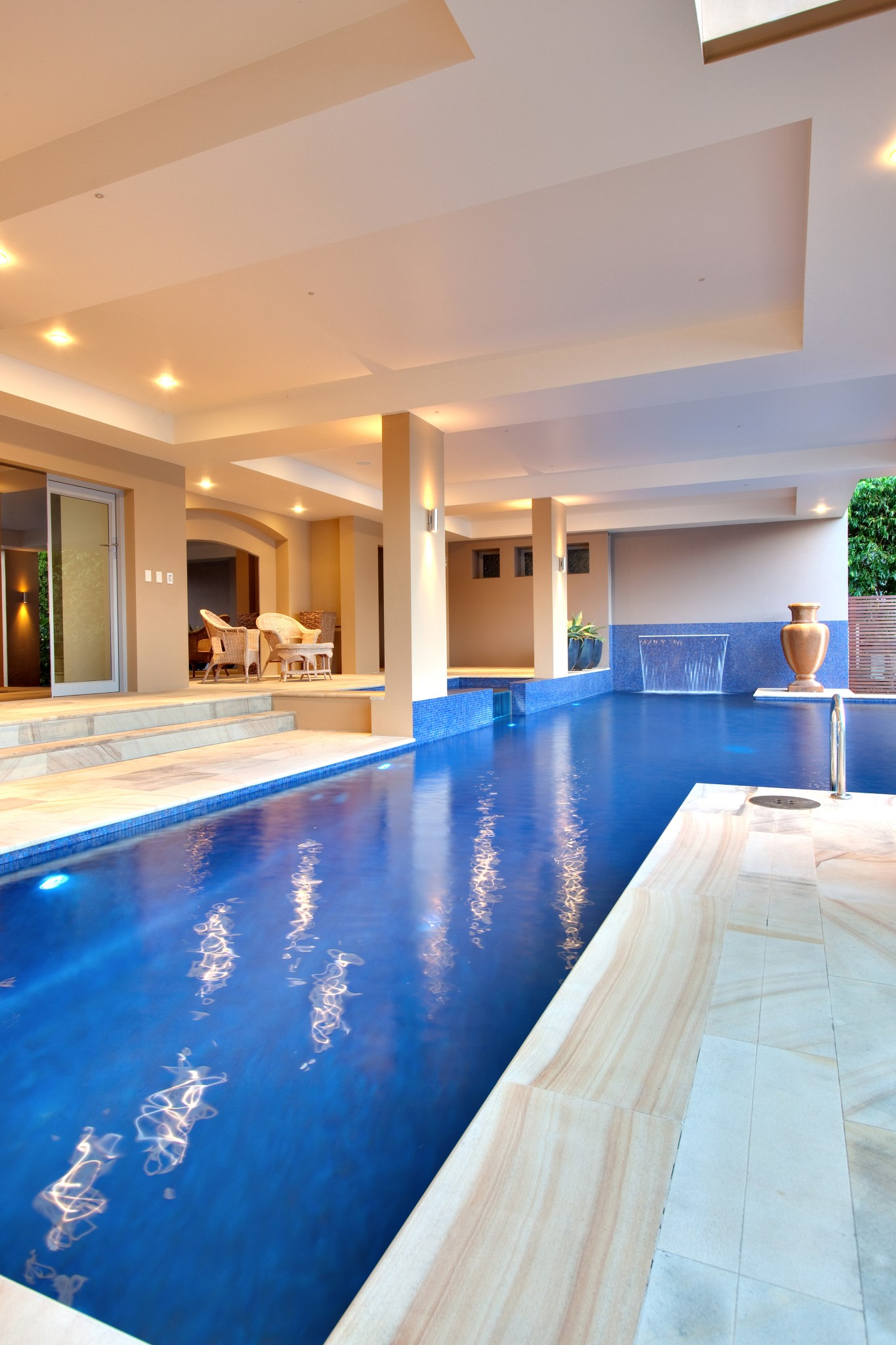 Luxury house and swimming pool with modern water features