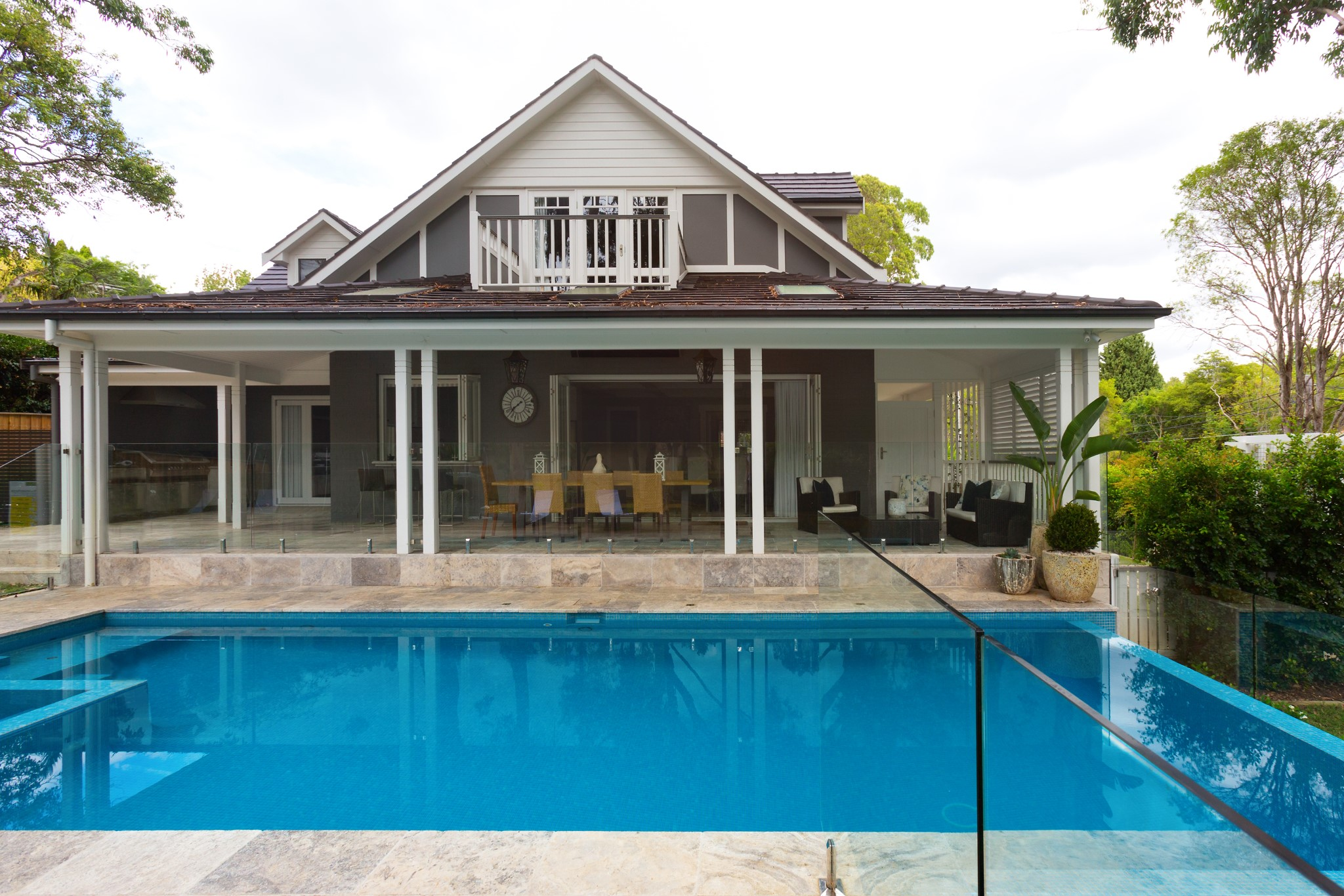 Classic design swimming pool in front of the house