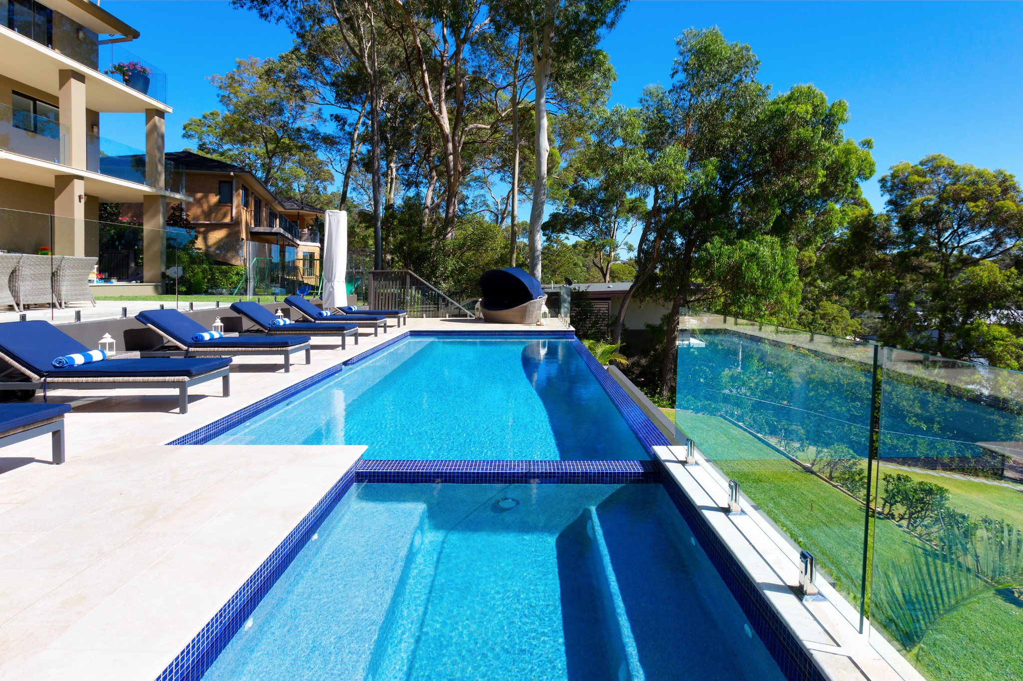 Classic Design of swimming pools in front of the yard in luxury house