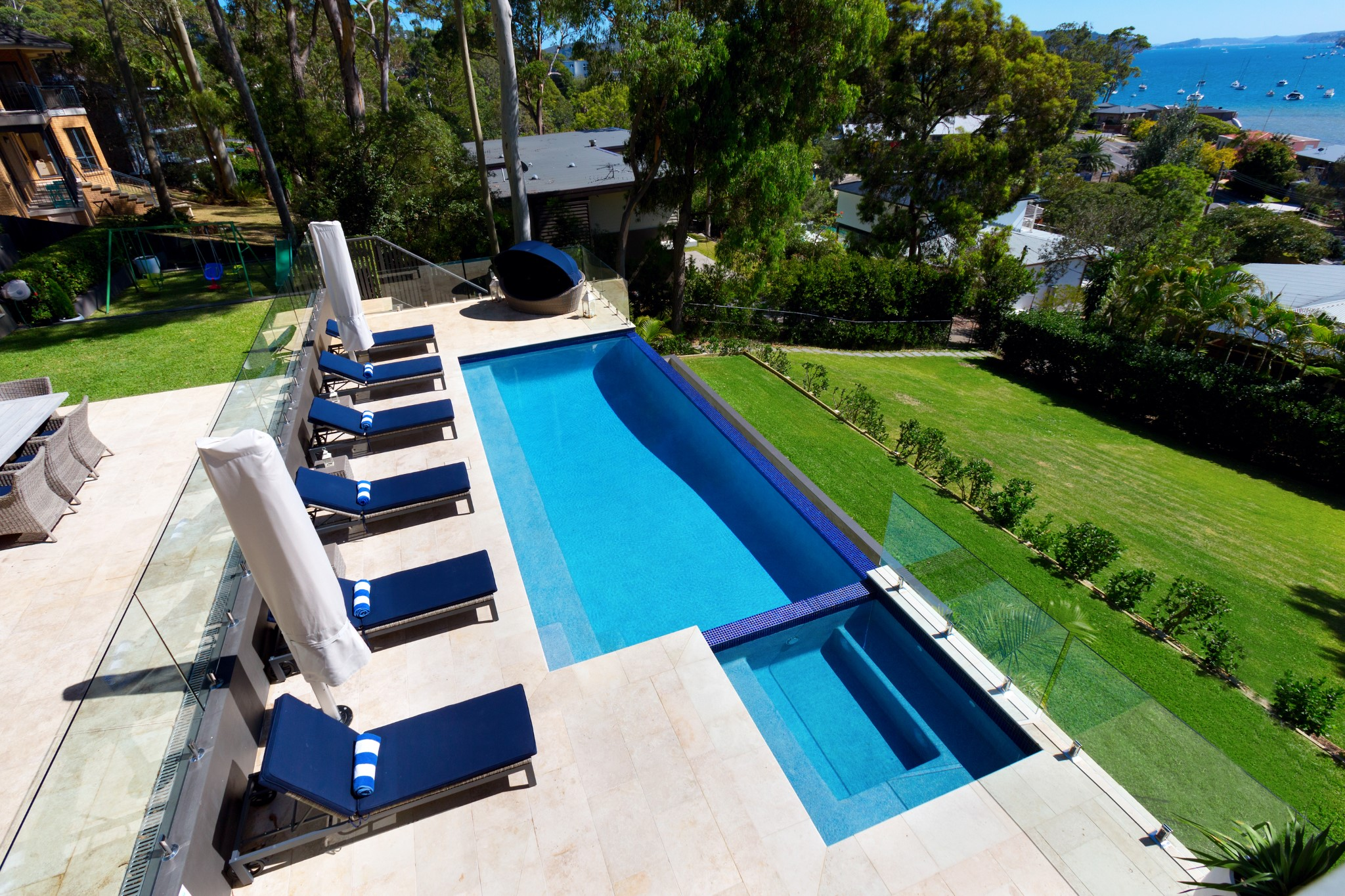 Classic Design of small and large swimming pools in front of the spectacular view