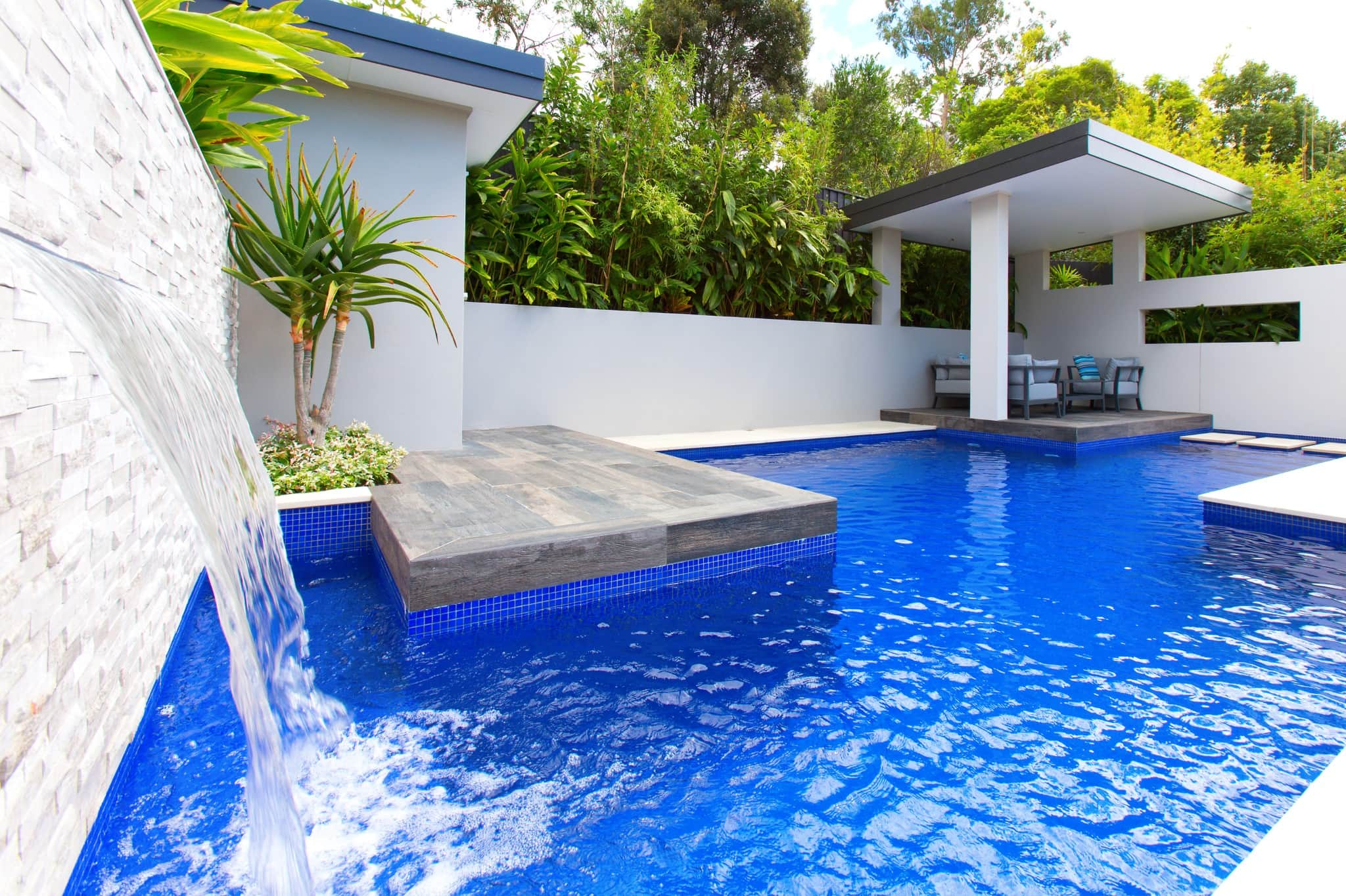 Fully Tiled Ezzari Glass Mosaic pool with sheet fountain in Riverview
