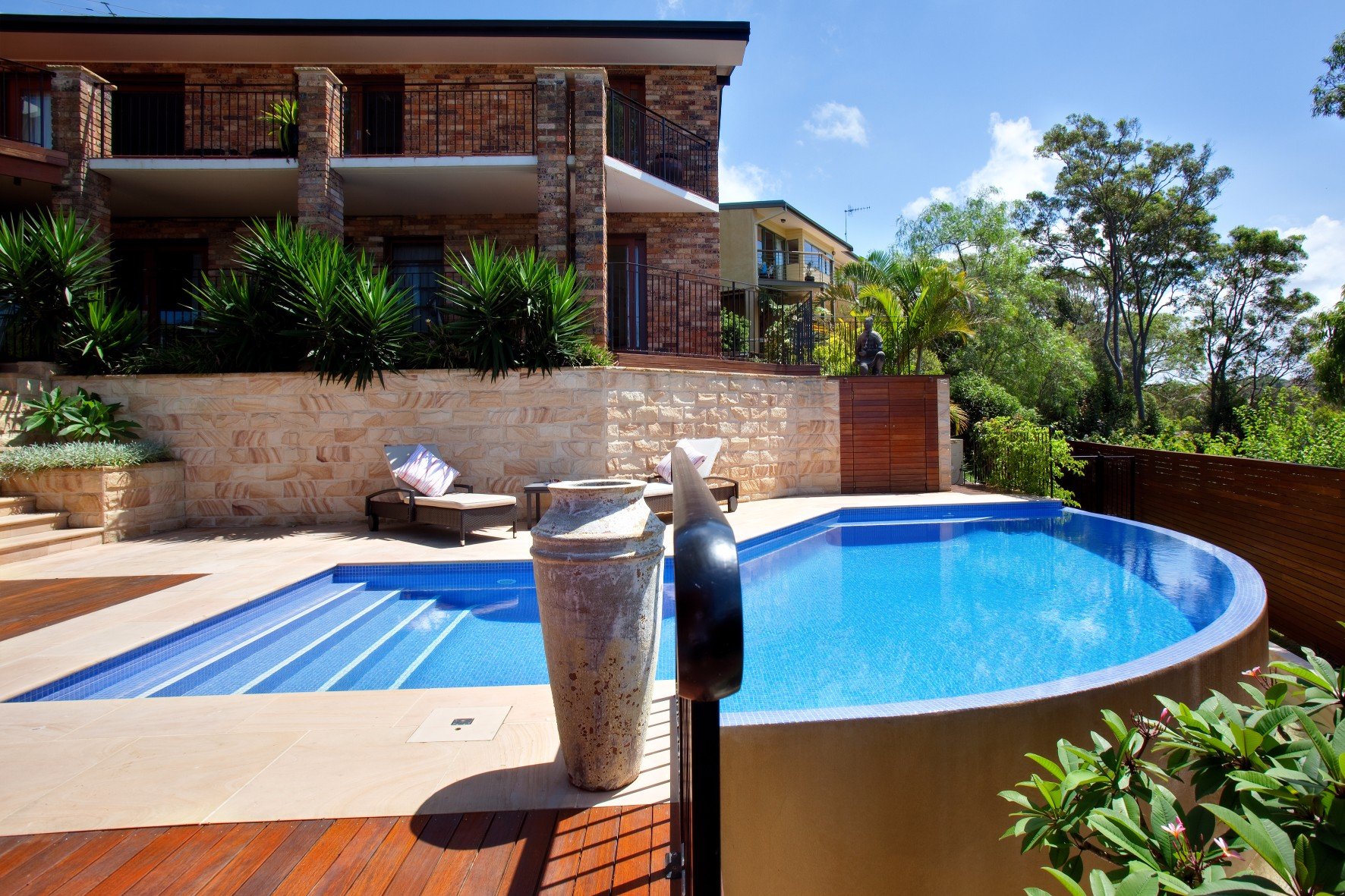 A luxurious infinite edge pool with bush view in Sydney