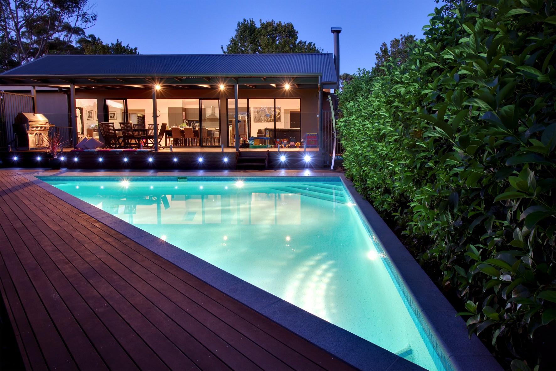 A custom-designed triangle shaped concrete swimming pool