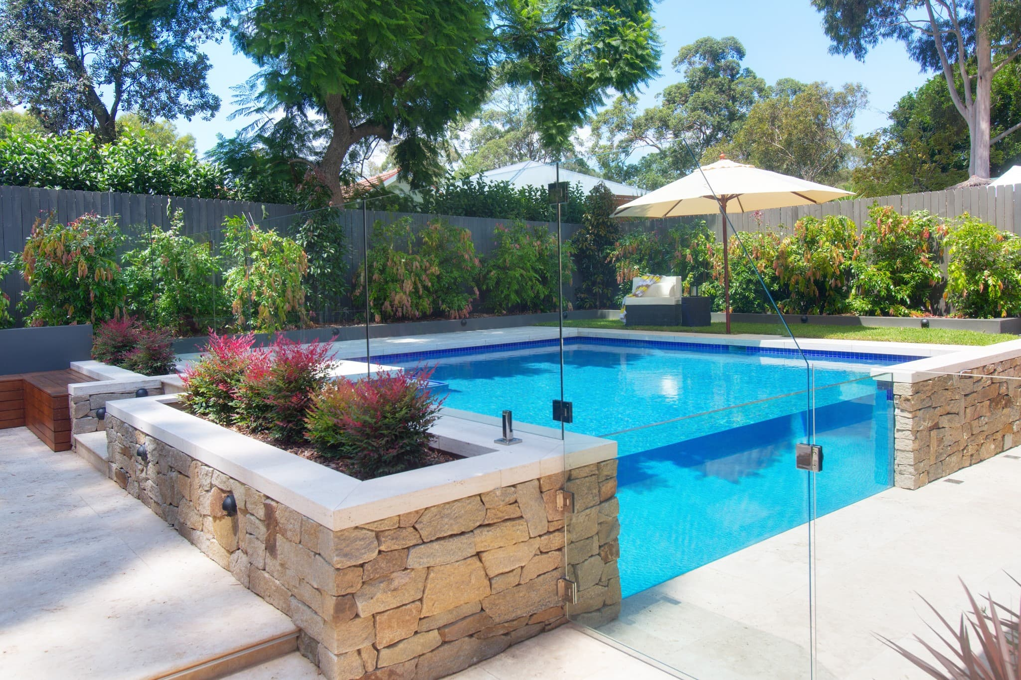 Beautiful swimming pool with marble floor around in West Pymble
